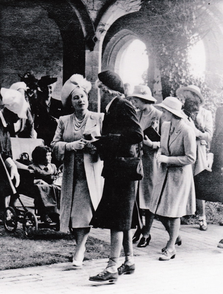 Winifred with back to the camera The Queen and the Princesses in the cloisters in June 1945